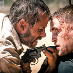 Look At This Bloodied First Image Of THE ROVER With Guy Pearce And Robert Pattinson